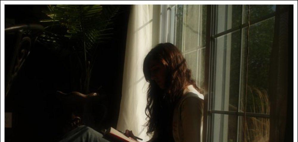 cropped-girl-reading-window-2470252246.jpg